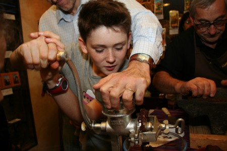Grinding the Cocoa Beans with a Hand-cranked Grinder