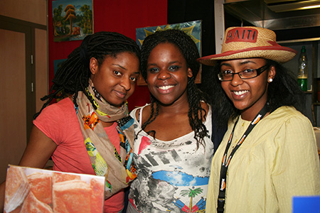 Three Young Women at the Délices d'Haïti Stand