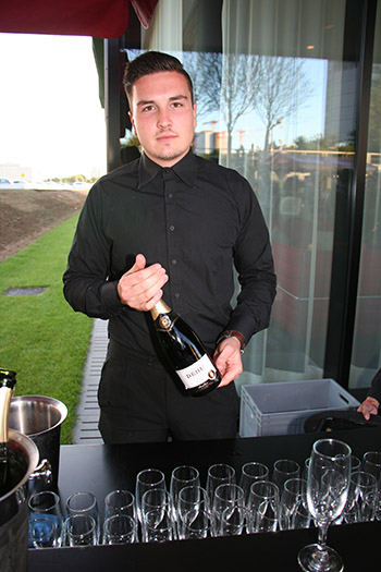 Idris Harput Serving Champagne
