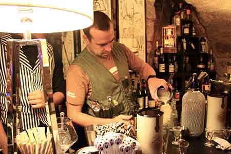 Bartender Preparing a Forest Collins