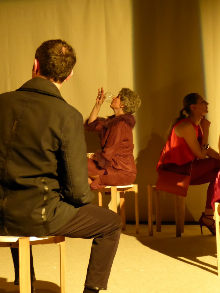 Gordon (Marc Marchand) sits with his back to the audience; Mrs. Gottlieb (Dorli Lamar) and Gordon's mistress (Fiamma Bennett) in profile in the background