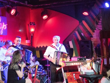 Muriel Privat (on left with microphone),  Jo Privat, Junior (on right with accordion)